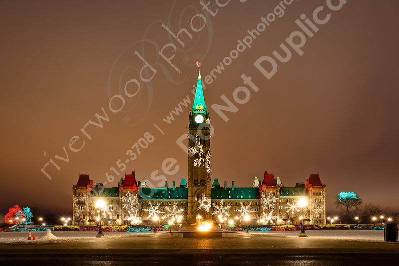 I was wandering around downtown Ottawa waiting to photograph the lunar eclipse. It was a very cloudy night and it gradually became more and more obvious that the eclipse was not in the cards for me. On the way out of town I stopped by Parliament Hill to create a few images of the Hill with all the Christmas Lights in full display. It's a beautiful scene and obviously very photogenic!!..©2010, Sean Phillips.http://www.RiverwoodPhotography.com (Sean Phillips)
