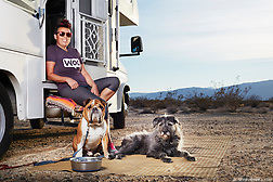 A pair of dogs, Buhhda and Ernie, sit outside their motorhome while camping in the Anza Borrego State Park, California. (Seth K Hughes)