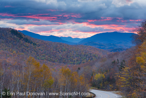 Silhouette of mountains at sunrise along Route 112 in Woodstock, New Hampshire USA. This area was part of the Gordon Pond Railroad, which was a logging railroad in operation from 1905-1916.