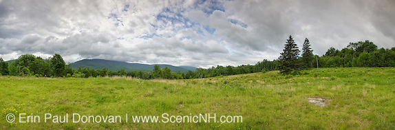 Panoramic of Breezy Point in Warren, New Hampshire USA during the summer months. These fields were once the site of 19th century resort hotels known as Merrill's Mountain Home, the Breezy Point House and the Moosilauke Inn. This image consists of nine images stitched together.
